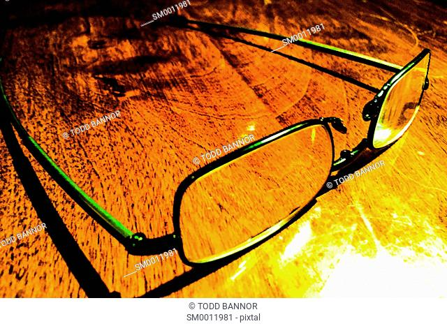 Reading Glasses on wood table