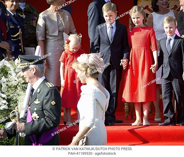 New King Philippe and Queen Mathilde and Princess Elisabeth, Prince Gabriel, Prince Emmanuel and Princess Eleonore reviews the civil and military troops at the...