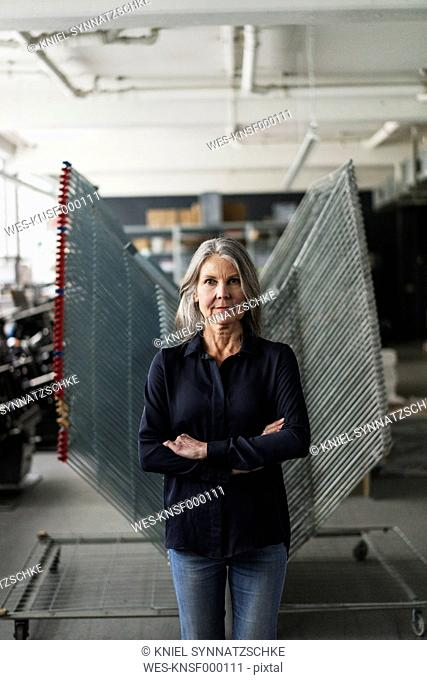 Confident senior woman in a printing shop
