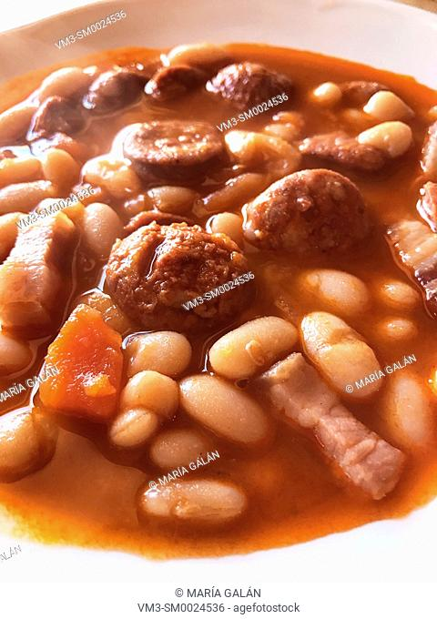 Beans stew with chorizo, bacon and carrot. Close view