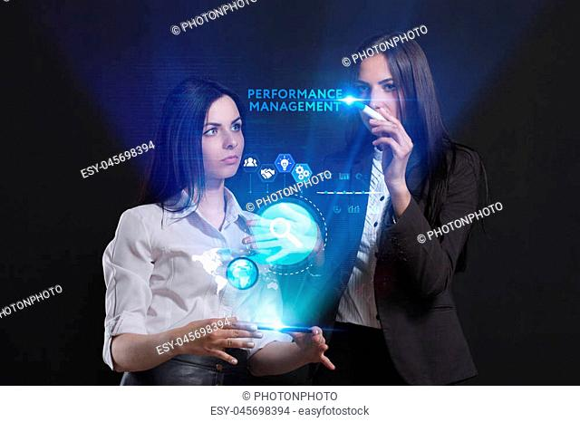 The concept of business, technology, the Internet and the network. A team of business women working on the virtual screen of the future and see the inscription:...