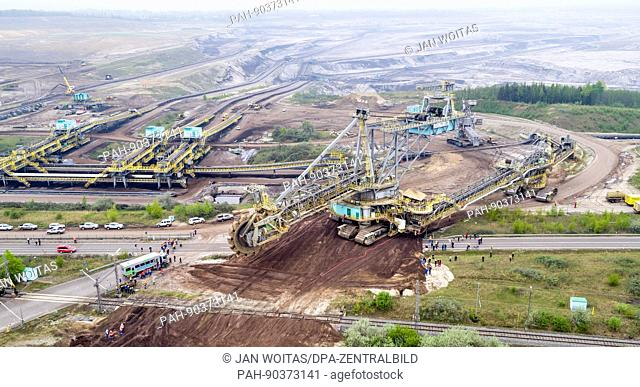 A bucket-wheel excavator weighing 2,850 tons crosses a road at the open cast mine in Profen, Germany, 4 May 2017. (Aerial photograph using a drone)