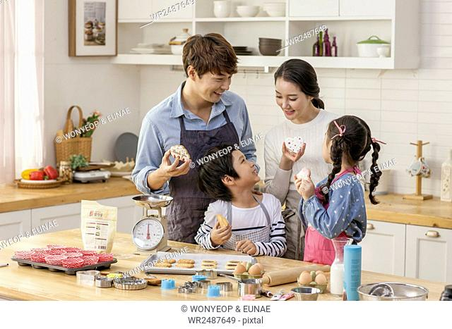Harmonious family eating Christmas cookies