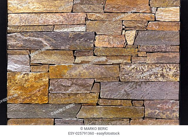 Close up shot of rough stone tiles wall