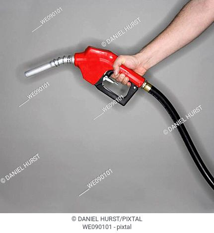 Man holding gas nozzle