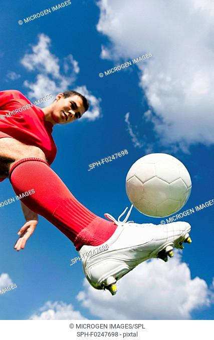 Soccer player controlling ball