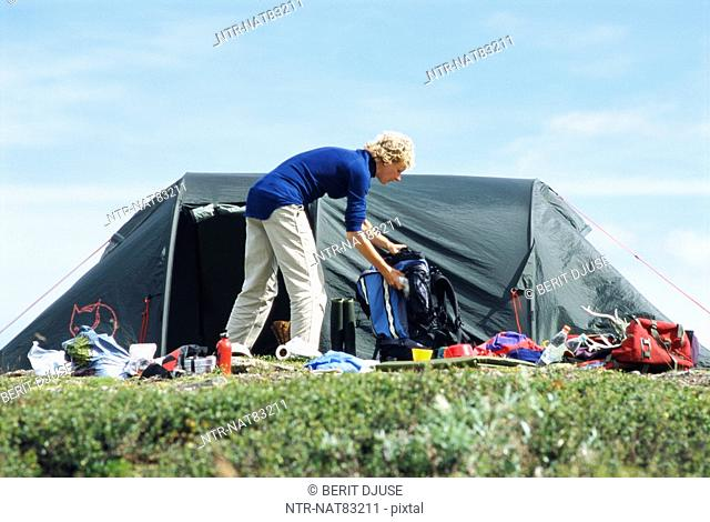 Woman by a tent in the mountains, Sweden