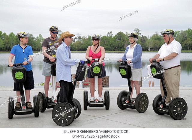 Florida, Orlando, Kissimmee, Celebration, planned community, Segway, personal transport, man, woman, boy