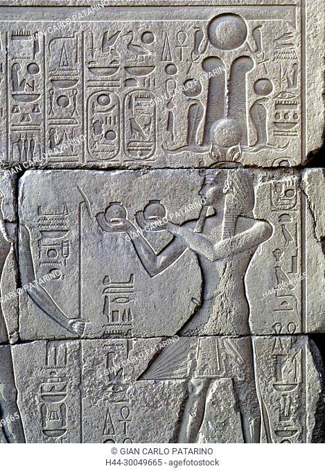 Karnak, Luxor, Egypt. Temple of Karnak sacred to god Amon: X° pylon with hieroglyps of the king Horemheb wearing the atef crown