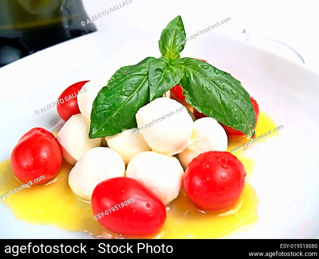 cherry mozzarella caprese, with tomatoes, oil and basil