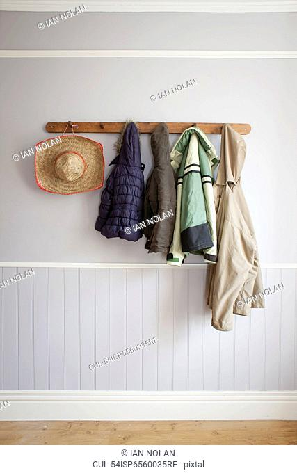 Coats and hat on coat rack