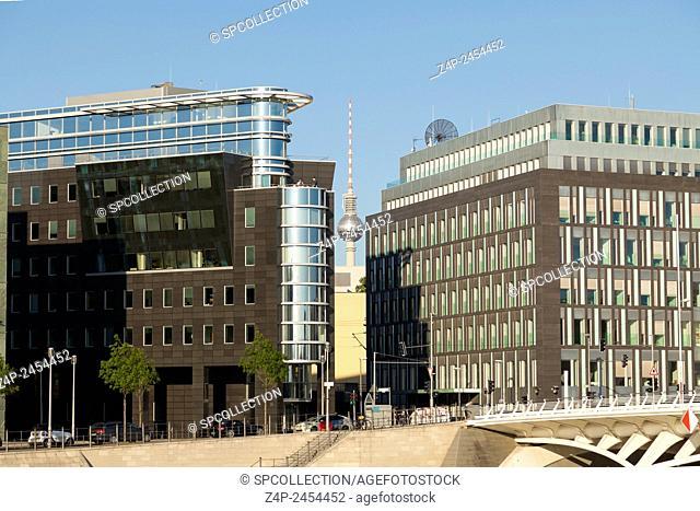 Television tower in Berlin between office buildings