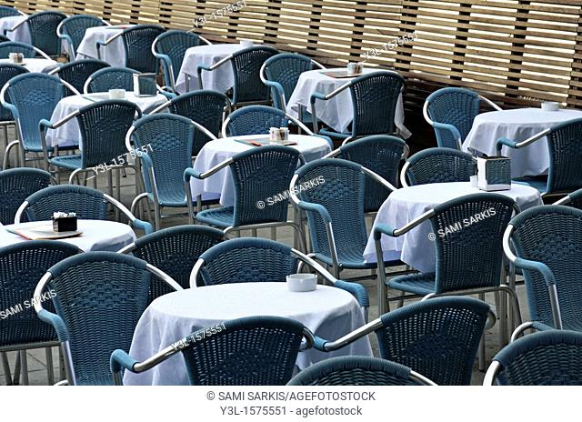 Empty restaurant seats and tables, Piazza San Marco, Venice, Italy
