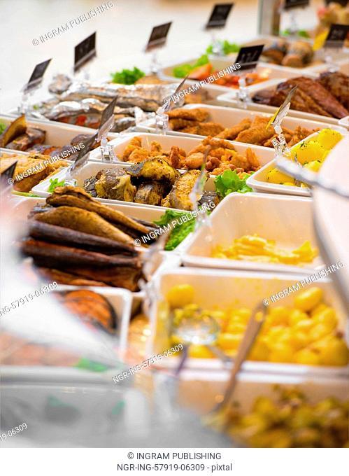 Grocery store. Different served meals on sale