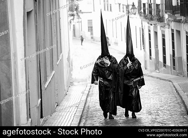 spanish holy week in seville with nazarenes and religious celebration
