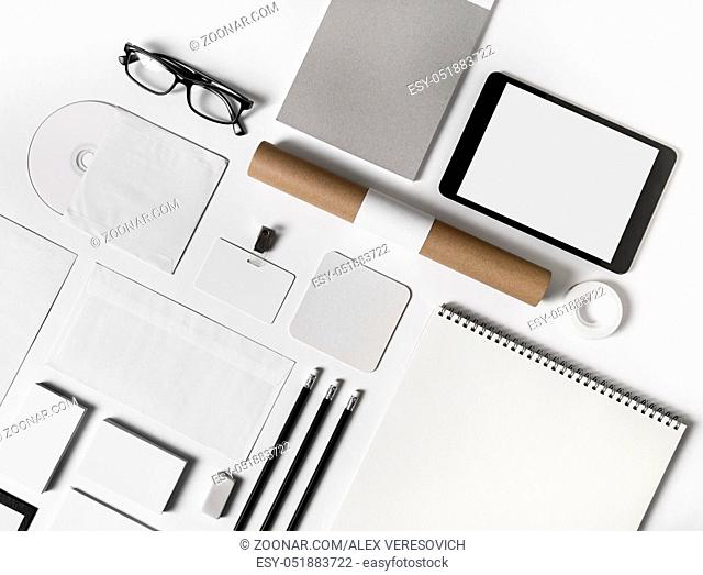 Photo of blank stationery set on white paper background. Corporate identity mock up for placing your design. Top view