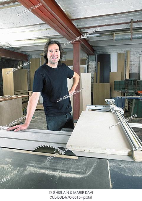Portrait of carpenter in his workshop