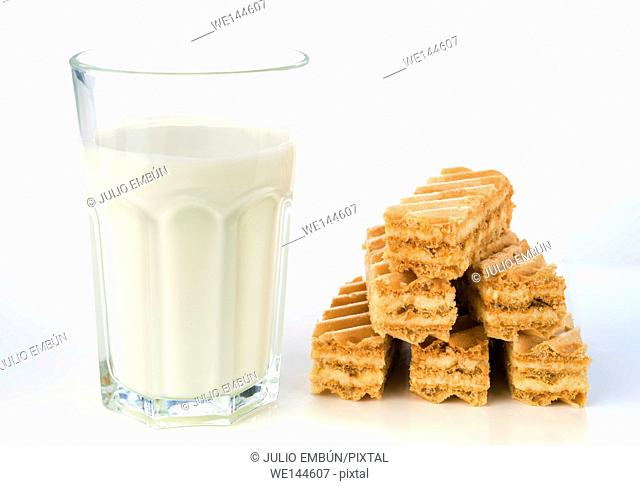 breakfast biscuits with glass of milk cow isolated
