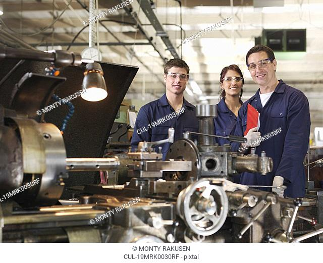 Engineer With Male & Female Apprentices