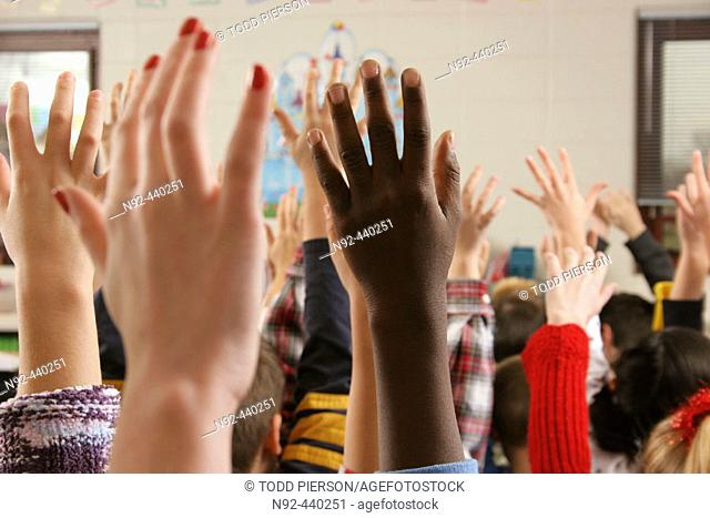 hands in air shot at public school in suburb of Chicago, Illinois. USA