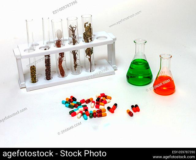 Group of laboratory flasks empty or filled with a clear liquid on white background