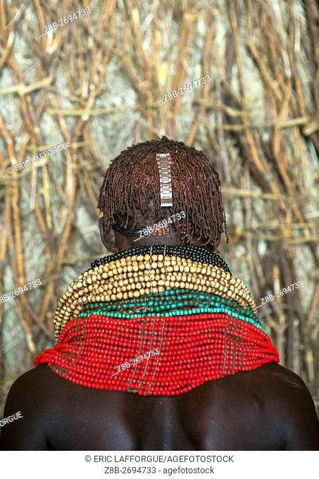 Ethiopia, Omo Valley, Kangate, nyangatom tribe woman with piles of beads