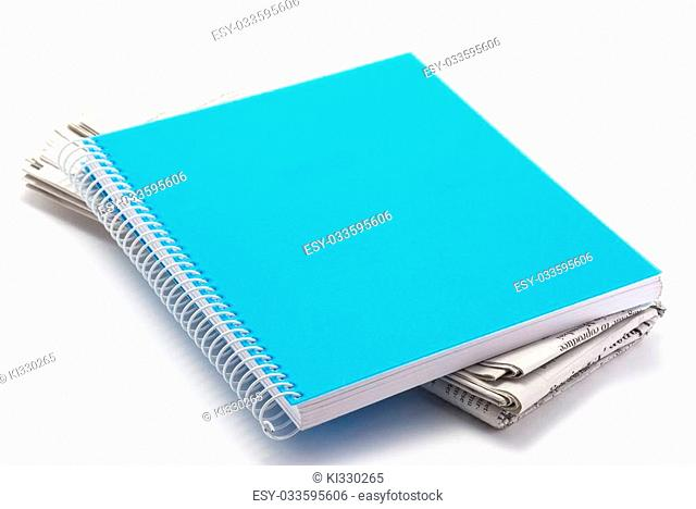 notebook and news paper on white background