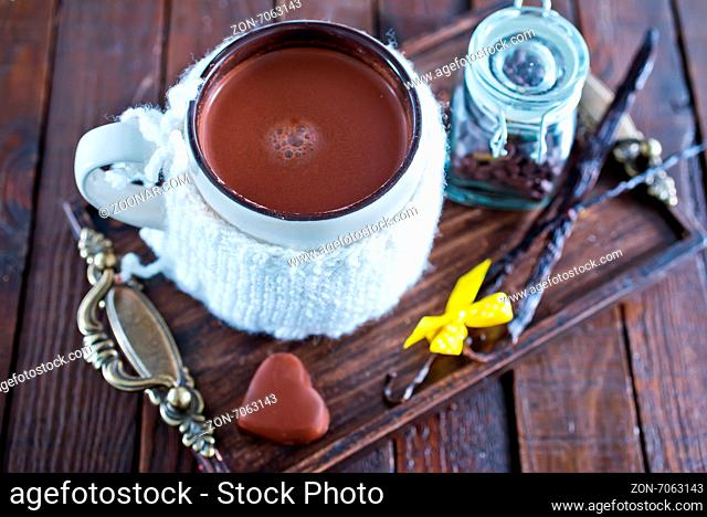 cocoa drink in cup and sweet cookies