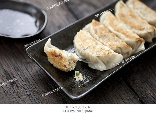 A platter of Gyoza with Soy dipping sauce