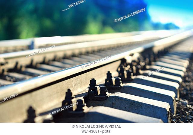 Diagonal countryside railway bokeh background