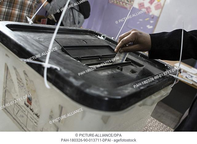 Egyptian man casts his vote on the first day of the 2018 Egyptian presidential elections, at a polling station, in Cairo, Egypt, 26 March 2018