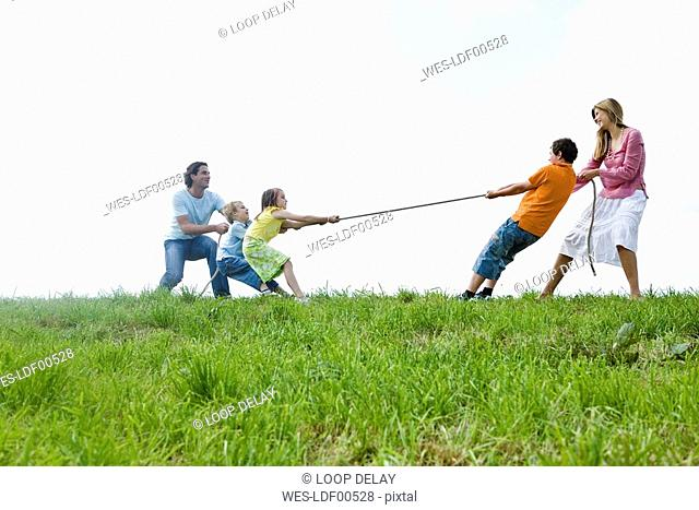 Family pulling rope, close-up