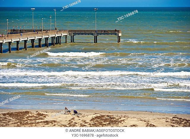 Beach with fishing pier in Port Aransas Texas