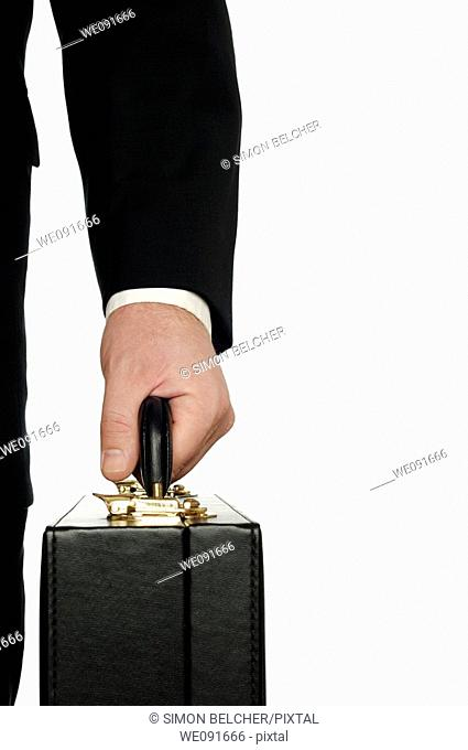 Businessman Carrying a Briefcase Close Up, Against a White Background
