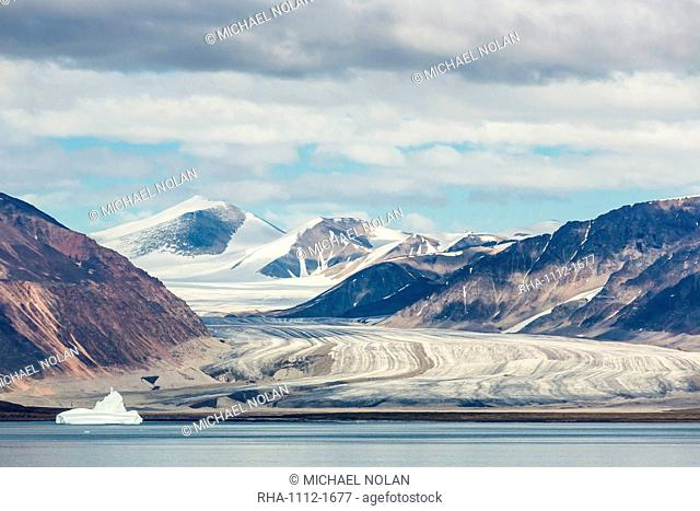 View of snow-capped mountains from Cape Hay, Bylot Island, Nunavut, Canada, North America