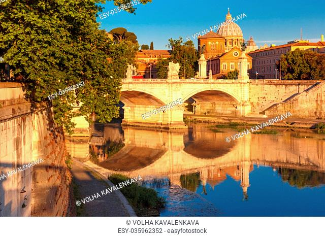 View of Tiber River, bridge Vittorio Emanuele II and Saint Peter Cathedral in the morning in Rome, Italy