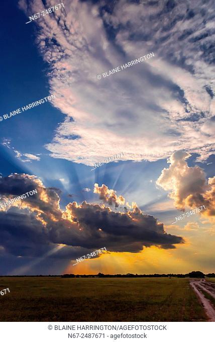 Sunset behind clouds, Nxai Pan National Park, Botswana