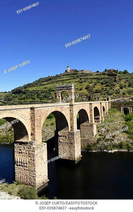 Roman bridge over the Tajo river in Valencia de Alcantara, Extremadura, Spain. (In the top view of the town of Valencia de Alcantara)