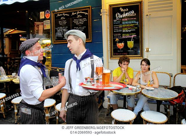 France, Europe, French, Paris, 18th arrondissement, Montmatre, Place du Tertre, man, waiter, restaurant, cafe, uniform, coworkers,