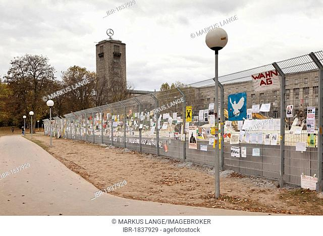 Protest posters against Stuttgart 21 railway project on a site fence behind the main railway station, Schlossgarten, castle gardens, Stuttgart