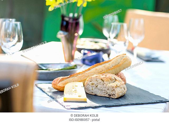 Party garden table with cheese board and bread