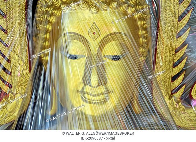 Buddha statue covered with plastic foil, produced in a small factory, Bamrung Muang Road, Bangkok, Thailand, Asia, PublicGround