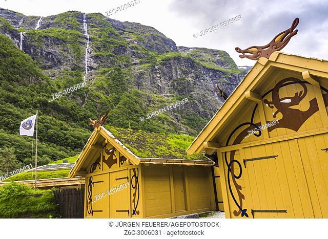 modern Viking huts at the village Gudvangen in the Næroyfjorden, Norway, valley with plumping waterfalls, Sea Kajak centre Nordic Ventures