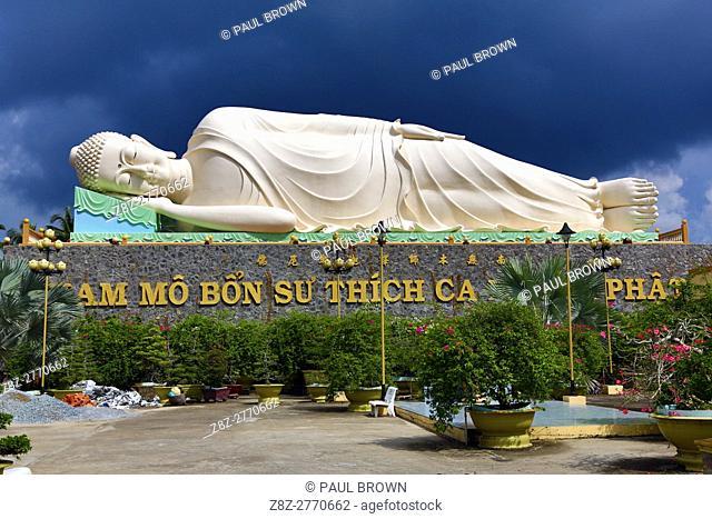 Reclining Buddha statue at Vinh Trang Buddhist Temple, near My Tho, Mekong Delta, Vietnam