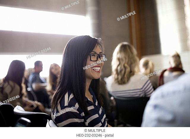 Enthusiastic student in auditorium audience