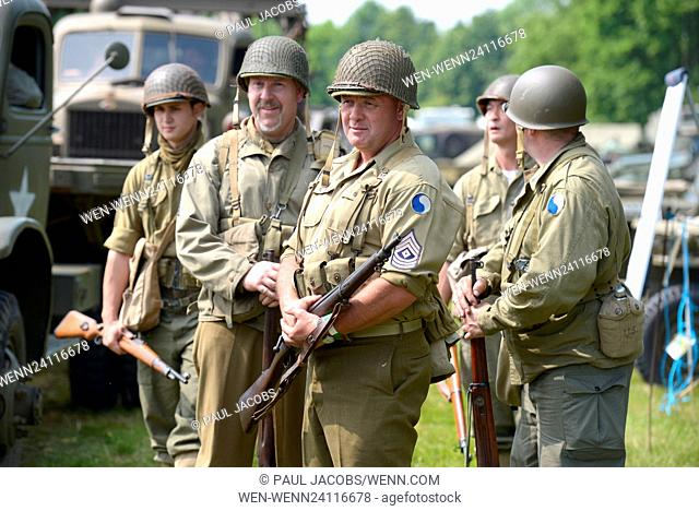 Pictured on a warm bank holiday weekend is the Solent Overlord WW2 show in Denmead, Hampshire, UK. The show attracts over 4000 visitors over the weekend with...