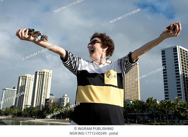 Woman feeding pigeons on the beach, Waikiki, Diamond Head, Kapahulu, Honolulu, Oahu, Hawaii, USA