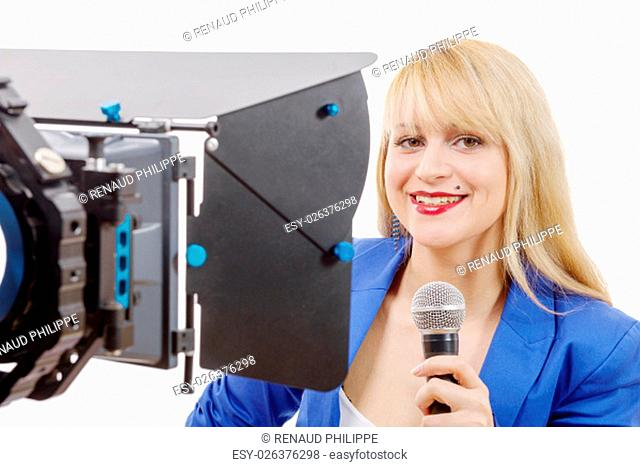 a portrait of elegant blonde woman TV reporter, who is smiling