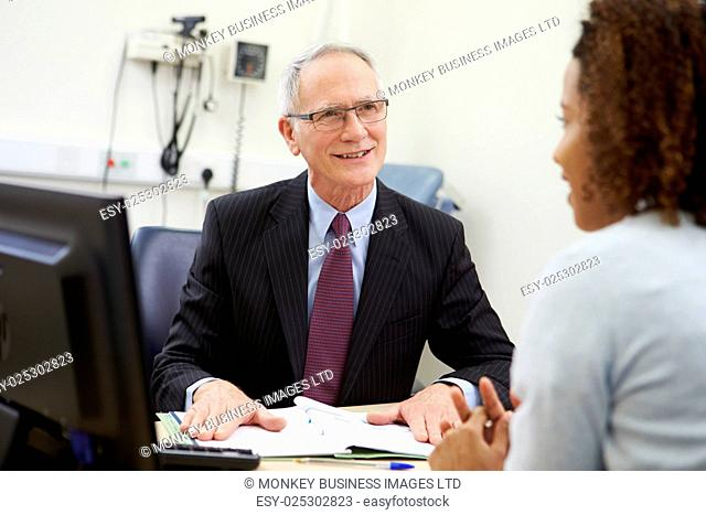 Consultant Meeting With Patient In Office