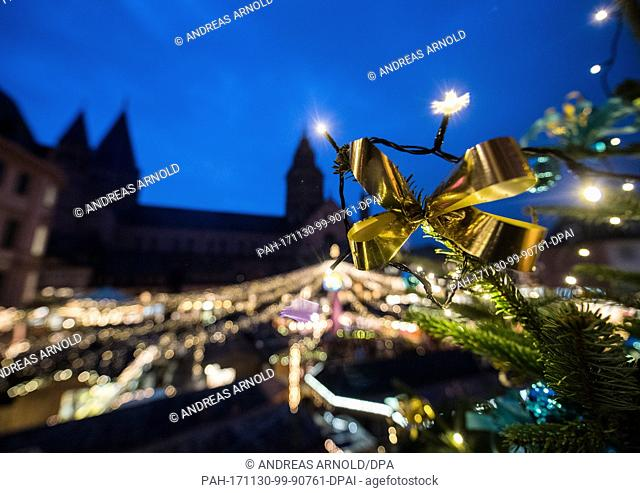 A Christmas tree shines in the night during the opening of the Christmas market in Mainz, Germany, 30 November 2017. The Christmas market is open from 30...